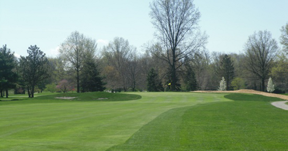 The 13th Hole is a challenging long par 4 played into a southerly breeze most of the time. The tee shot is played from a chute of trees to a narrow fairway defined by sand on the left. The raised green has a feature bunker on the L hand side, but the player needs to stay below the pin - especially with a most dangerous front hole location, bringing a false front into play. Always a good idea to check out the pin placement on the 14th while you are walking up the fairway.